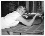 Girl with rifle at Cimarroncita Ranch Camp