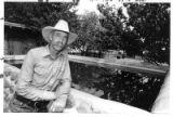 Archie West, cattle rancher, next to his family's reservoir on the ranch off Hwy 14 in Cerrillos,...
