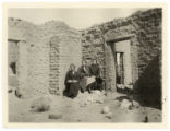 A ruined adobe near Rodey, New Mexico, Vivian and I [Ivah Schumaker?]and Mrs. [Bower?]