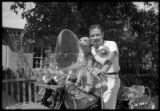 "John S. Candelario with his Harley-Davidson named ""Tarzan"" and his beloved dog Cindy"