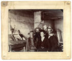 Five men in printing shop, La Jara, Colorado
