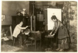 Ernest L. and Mary G. Blumenschein painting in studio, New York, NY