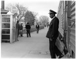 """Train stop in Albuquerque,"" African-American uniformed employee of  Atchison, Topeka..."