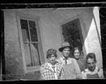 Group by adobe building, possibly including Amy Brown on left, in New Mexico