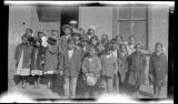 Group of children outside adobe building (probably students of Floy Brown), New Mexico