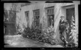 Ralph Emerson Twitchell in doorway, patio, Palace of the Governors, Santa Fe, New Mexico