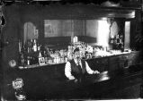 Bartender in saloon, Hillsboro, New Mexico