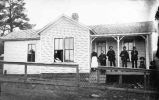Family group in front of home in the mining area of Hillsboro and Kingston, New Mexico