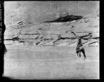 Navajo on horseback, unidentified ruin, Canyon de Chelly, Arizona