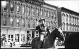 Governor Thomas Mabry on horseback at the Cowboys' Reunion Parade, Las Vegas, New Mexico