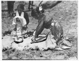 Navajo girl grinding meal, Coyote Canyon, New Mexico