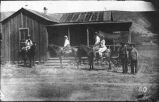 Family on horseback in front of home in area of Hillsboro and Kingston, New Mexico