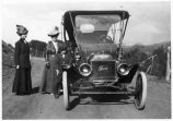 Glenn Aultman, mother and friend standing next to 1910 Model T Ford