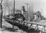 Denver and Rio Grande engine on tressle in front of Guadalupe Church, northbound from Santa Fe,...
