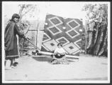 Reyecita Romero and baby Juanita with Navajo rug, Cochiti Pueblo, New Mexico