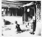 Woman cooking at Hano, Hopi, Arizona