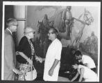 James T. Forrest, Director of Museum of New Mexico with Ina Cassidy and conservator John Pogzeba...