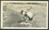 Woman washing clothes in river, Jemez Pueblo, New Mexico