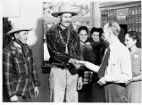 Navajo man being congratulated for buying United States War Bond, New Mexico