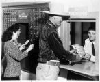 Navajo man buying United States War Bond, New Mexico