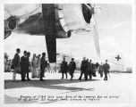 """Shadow of C-54 falls upon Sons of the (setting) Sun on arrival at IE SHIMA, 20 August, 1945,..."