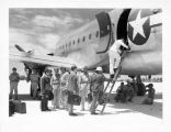 American and Japanese military personnel, following Japanese surrender, boarding aircraft for...