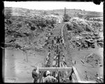 Rebuilding bridge, El Paso and Northeastern Railroad, Pintado Canyon, New Mexico, May 11, 1902