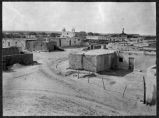 View of Isleta Pueblo showing Mission Church in background, New Mexico