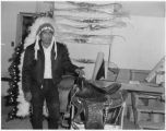 Unidentified Laguna Pueblo man with prize winning saddle, New Mexico
