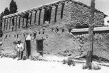 Man in uniform outside the Oldest House, Santa Fe, New Mexico