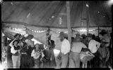 Band playing under tent, Socorro, New Mexico