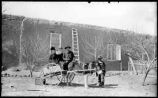Group with donkey and cart, Socorro, New Mexico
