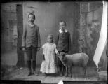 Portrait of children with pet sheep, Socorro, New Mexico