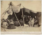 General William T. Sherman and other military personnel and Indian Peace Commissioners negotiating...