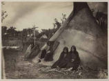 Women and children outside tipi in Cheyenne, Arapahoe or Kiowa camp