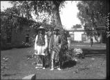 Santa Clara Governor Naranjo and San Ildefonso man in Palace of the Governors courtyard, Santa Fe,...