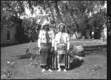 Joe Chavarilla and Damacio Tafoya, Santa Clara Pueblo in courtyard of Palace of the Governors,...