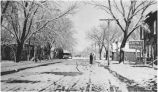 Street scene in winter showing Hotel Frank, Espanola, New Mexico
