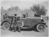 Pueblo man with woman and car, New Mexico