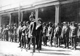 Rough Riders being sworn in by Captain Charles L. Cooper in front of the Palace of the Governors,...