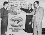 Governor Thomas J. Mabry (second from left) with a group from Los Alamos County, New Mexico
