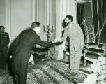 Frank V. Ortiz being presented at the court of his Imperial Majesty, Emperor Haile Selassie in...