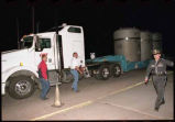 First truck loaded with containers of nuclear waste bound for the Waste Isolation Pilot Plant...