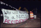 Banner protesting shipment of nuclear waste through Santa Fe from Los Alamos National Laboratory...