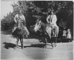 Two Taos men on horseback, Taos Pueblo, New Mexico