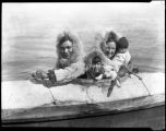 Unidentified Native American family in kayak