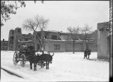 Wood vendor's wagon, Palace Avenue at the Plaza, Museum of Fine Arts in background , Santa Fe, New...