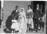 Unidentified wedding party outside church, New Mexico