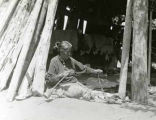 Navajo weaver spinning wool, photographed during Bernheimer Expedition, New Mexico