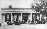 Military personnel and family members in front of the Post Chaplin's Quarters, Fort Union, New...